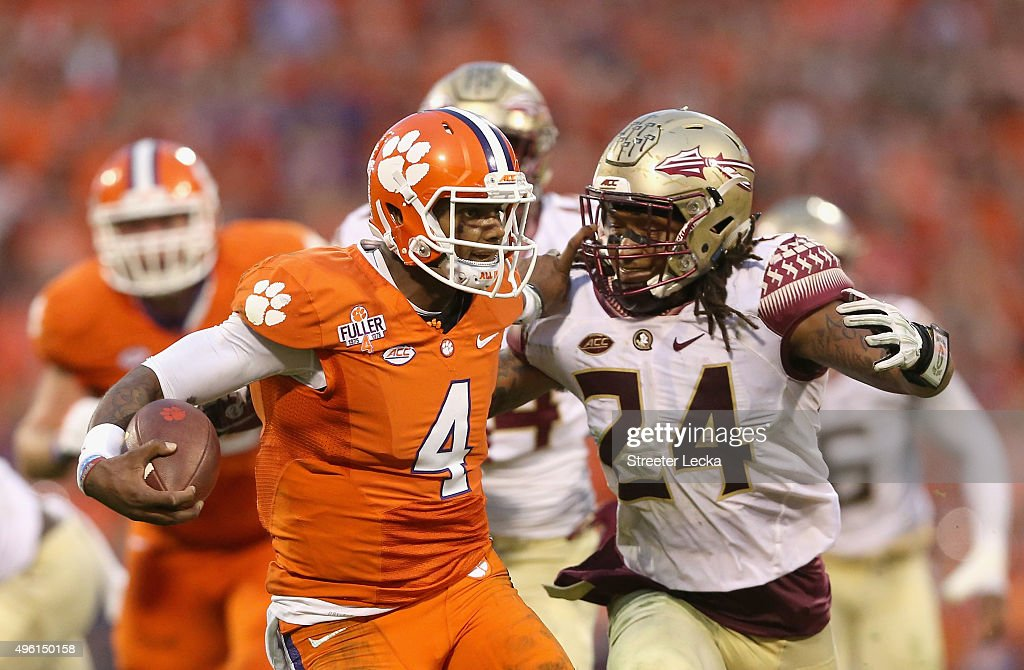 Terrance Smith #24 of the Florida State Seminoles tries to tackle Deshaun Watson #4 of the Clemson Tigers during their game at Memorial Stadium on November 7, 2015 in Clemson, South Carolina.