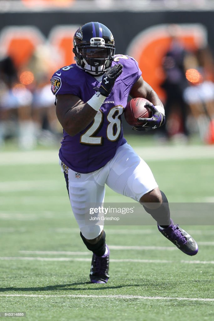 Terrance West #28 of the Baltimore Ravens carries the ball during the first quarter of the game against the Cincinnati Bengals at Paul Brown Stadium on September 10, 2017 in Cincinnati, Ohio.