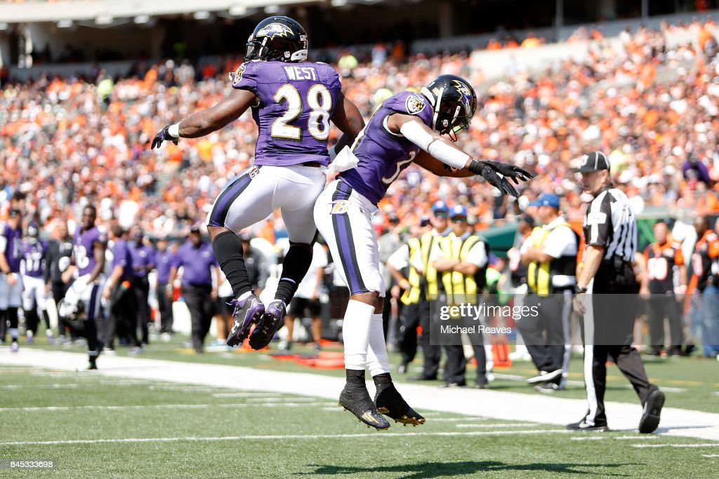 Terrance West #28 of the Baltimore Ravens is congratulated by Javorius Allen #37 of the Baltimore Ravens after scoring a touchdown during the second quarter of the game against the Cincinnati Bengals at Paul Brown Stadium on September 10, 2017 in Cincinnati, Ohio.