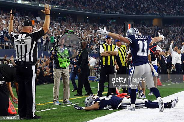 Terrance Williams of the Dallas Cowboys celebrates after catching a pass in the end zone for a touchdown during the second quarter against the...