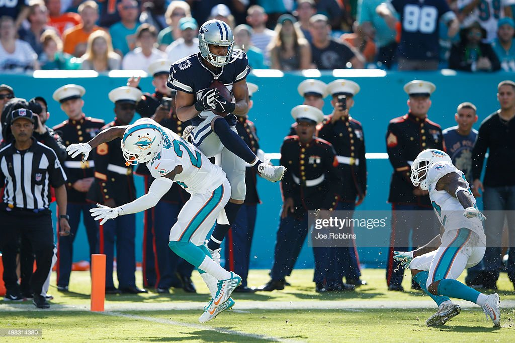 Terrance Williams #83 of the Dallas Cowboys makes a 31-yard touchdown reception against Brice McCain #24 of the Miami Dolphins in the second quarter of the game at Sun Life Stadium on November 22, 2015 in Miami Gardens, Florida.