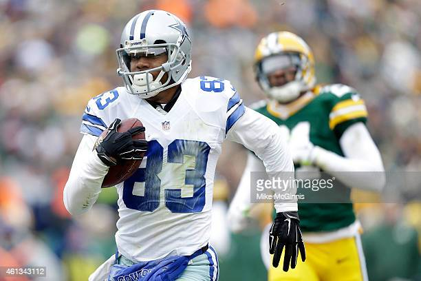 Terrance Williams of the Dallas Cowboys runs in the football for a touchdown in the second quarter of the 2015 NFC Divisional Playoff game against...