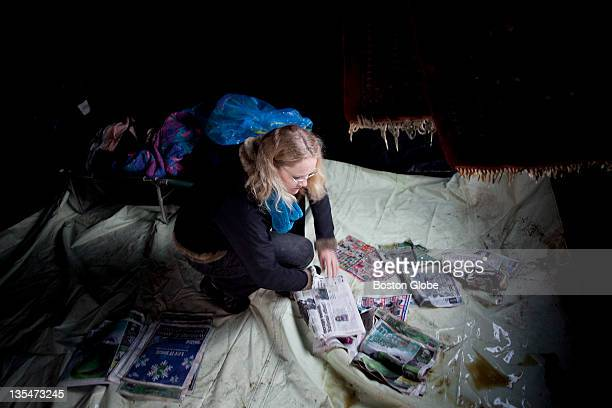 Terranova Kallemeyn a librarian from Allston mops up the floor of the 'Women's Safe Sleeping Space' a tent she put up for women who live in Occupy...