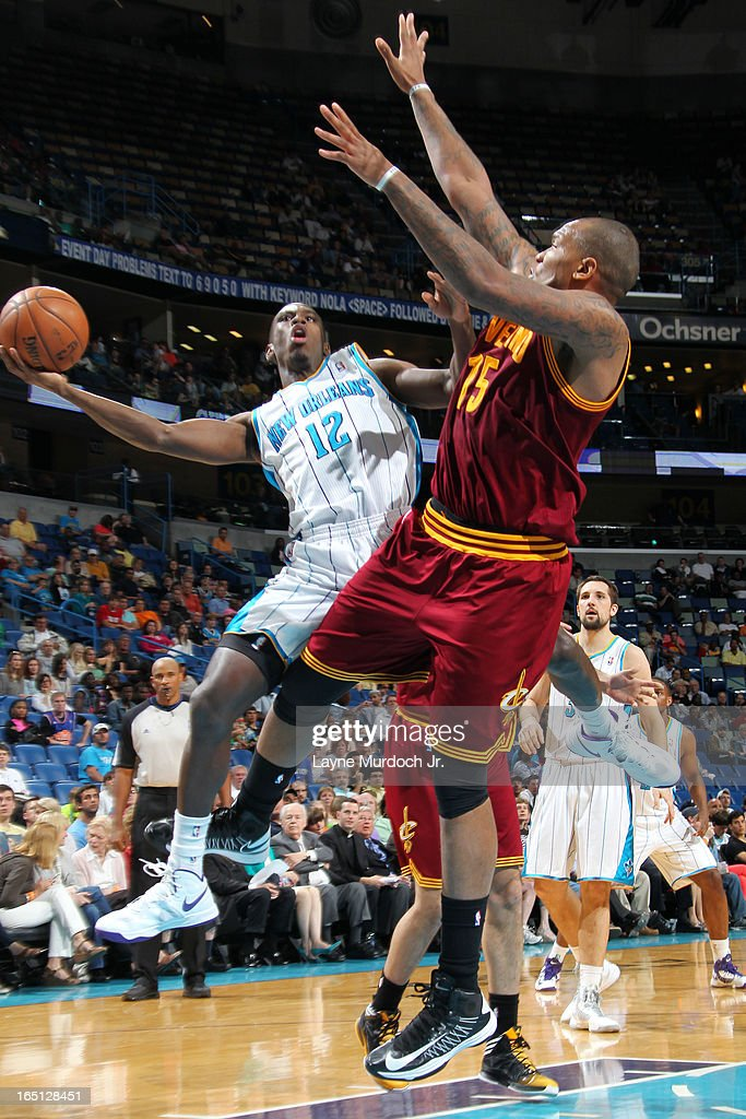 Terrel Harris #12 of the New Orleans Hornets shoots against Marreese Speights #15 of the Cleveland Cavaliers on March 31, 2013 at the New Orleans Arena in New Orleans, Louisiana.