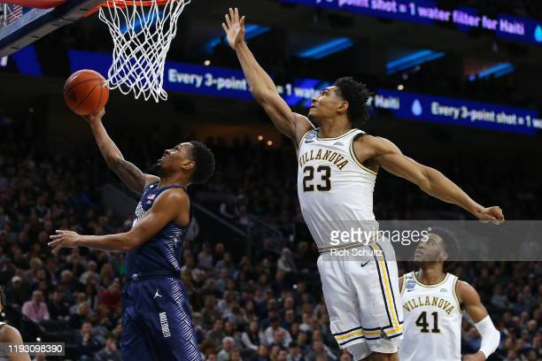 Terrell Allen of the Georgetown Hoyas attempts a layup as Jermaine Samuels and Saddiq Bey of the Villanova Wildcats defend during the first half of a...