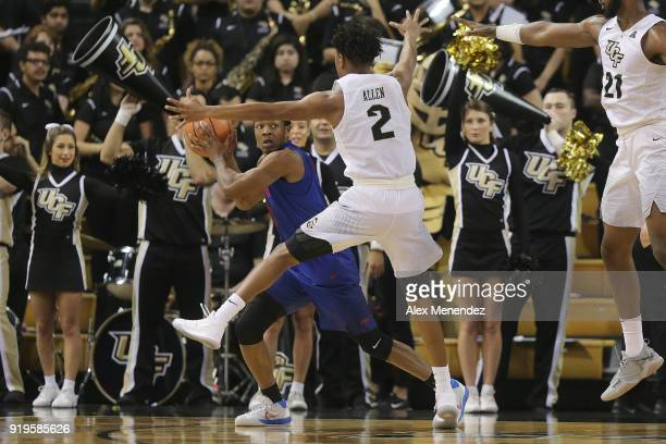 Terrell Allen of the UCF Knights defends against Jahmal McMurray of the Southern Methodist Mustangs during a NCAA basketball game at the CFE Arena on...