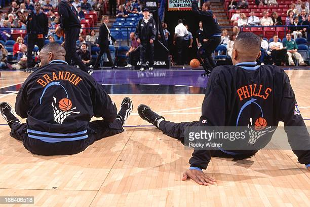 Terrell Brandon and Bobby Phills of the Cleveland Cavaliers stretch against the Sacramento Kings during a game played on March 11 1997 at Arco Arena...