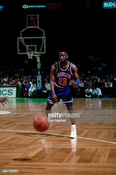 Terrell Brandon of the Cleveland Cavaliers bounce passes the ball against the Boston Celtics during a game played at the Boston Garden in Boston...