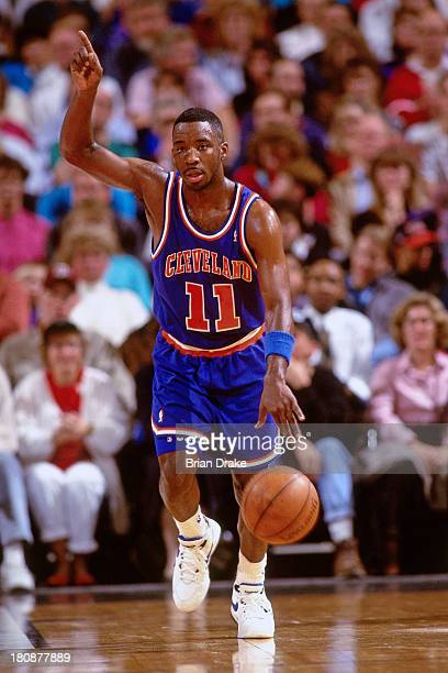 Terrell Brandon of the Cleveland Cavaliers brings the ball up court during a game played in 1992 at the Veterans Memorial Coliseum in Portland Oregon...