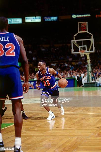 Terrell Brandon of the Cleveland Cavaliers dribbles against the Boston Celtics during a game played circa 1994 at the Boston Garden in Boston...