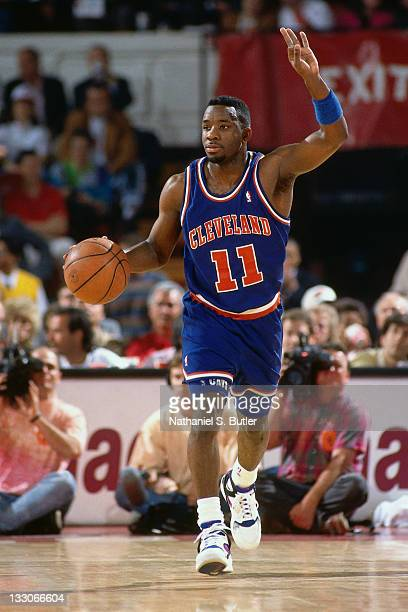 Terrell Brandon of the Cleveland Cavaliers dribbles circa 1991 at the Richfield Coliseum in Richfield Ohio NOTE TO USER User expressly acknowledges...
