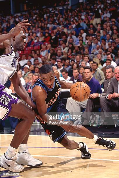 Terrell Brandon of the Cleveland Cavaliers dribbles the ball against the Sacramento Kings during a game played on March 11 1997 at Arco Arena in...