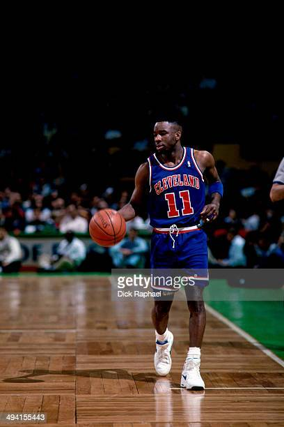 Terrell Brandon of the Cleveland Cavaliers dribbles the ball against the Boston Celtics during a game played at the Boston Garden in Boston...
