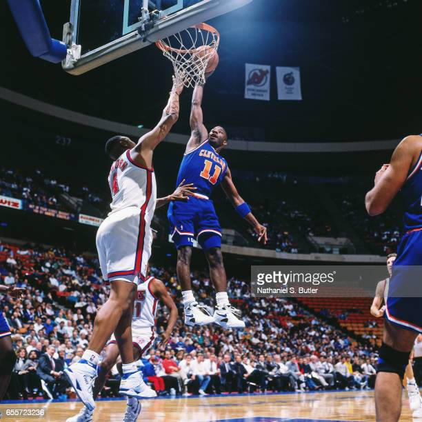 Terrell Brandon of the Cleveland Cavaliers dunks against the Ne Jersey Nets circa 1993 at the Contintental Airlines Arena in East Rutherford New...