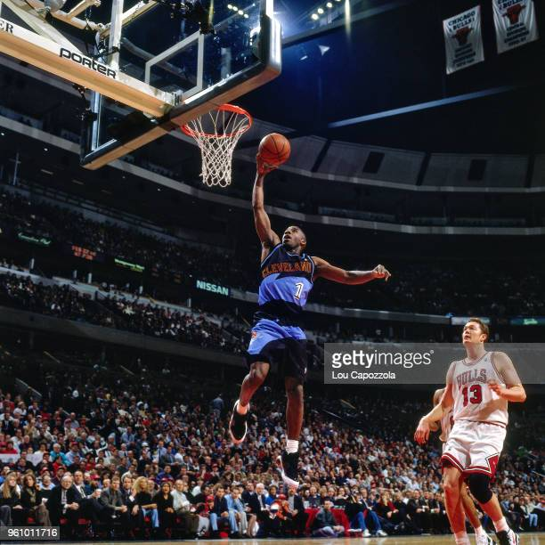Terrell Brandon of the Cleveland Cavaliers goes to the basket against the Chicago Bulls on February 20 1996 at the United Center in Chicago Illinois...