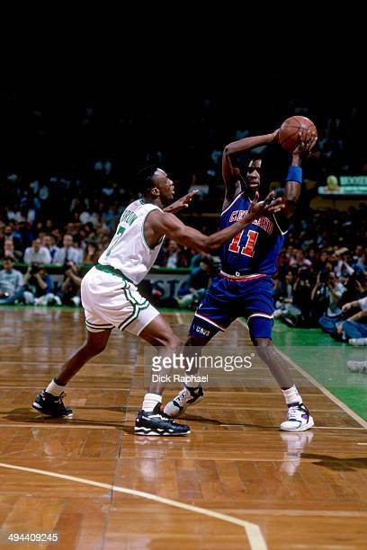 Terrell Brandon of the Cleveland Cavaliers handles the ball against Dee Brown of the Boston Celtics during a game played in 1992 at the Boston Garden...