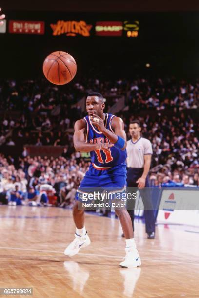 Terrell Brandon of the Cleveland Cavaliers passes the ball against the New York Knicks during a game played circa 1993 at the Madison Square Garden...