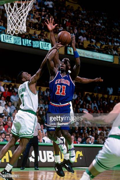 Terrell Brandon of the Cleveland Cavaliers shoots against Dee Brown of the Boston Celtics during a game played in 1992 at the Boston Garden in Boston...