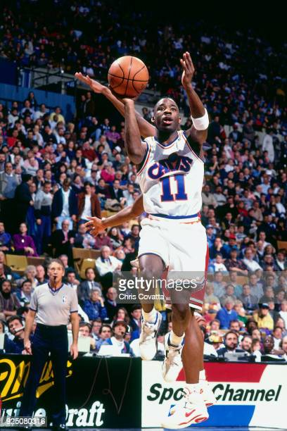 Terrell Brandon of the Cleveland Cavaliers shoots during a game played on January 27 1994 at the Richfield Coliseum in Richfield Ohio NOTE TO USER...