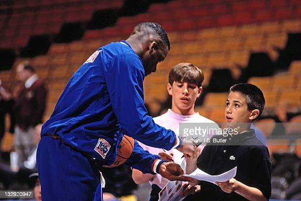 Terrell Brandon of the Cleveland Cavaliers signs autographs against the New Jersey Nets circa 1991 at the Brendan Byrne Arena in East Rutherford New...