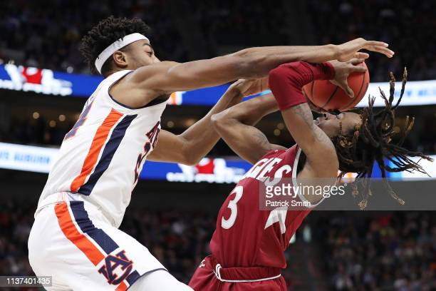 Terrell Brown of the New Mexico State Aggies attempts to shoot the ball against Anfernee McLemore of the Auburn Tigers during the second half in the...
