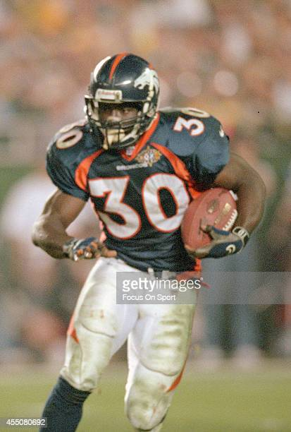 Terrell Davis of the Denver Broncos carries the ball against the Green Bay Packers during Super Bowl XXXII on January 25 1998 at Qualcomm Stadium in...