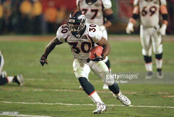 Terrell Davis of the Denver Broncos carries the ball against the Atlanta Falcons during Super Bowl XXXIII January 31 1999 at Pro Player Stadium in...