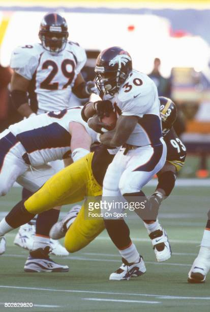 Terrell Davis of the Denver Broncos carries the ball against the Pittsburgh Steelers during an NFL football game circa 1997 at Three Rivers Stadium...