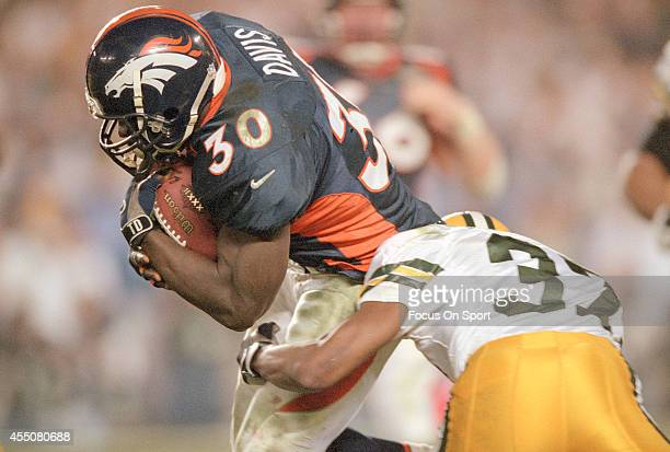 Terrell Davis of the Denver Broncos looks to break the tackle of Tyrone Williams of the Green Bay Packers during Super Bowl XXXII on January 25 1998...