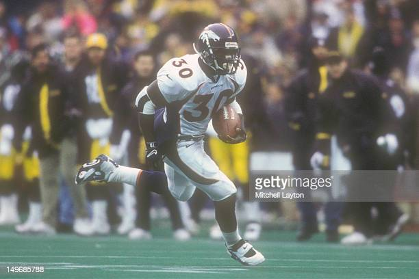 Terrell Davis of the Denver Broncos runs with the ball during a football game against the Pittsburgh Steelers on December 7 1997 at Three Rivers...