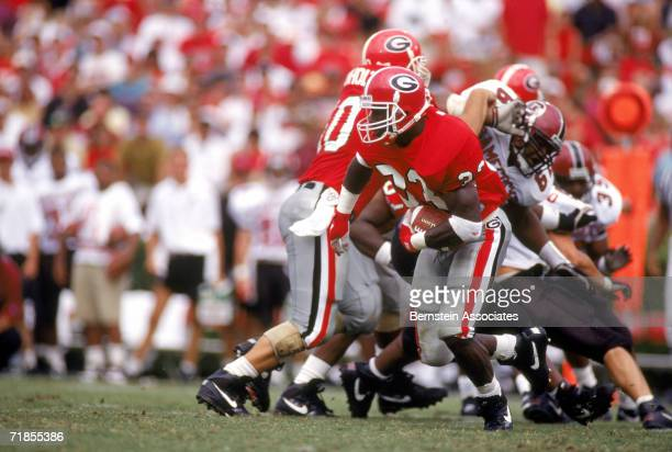 Terrell Davis of the Georgia Bulldogs rushes against the South Carolina Gamecocks in 1993 at Sanford Stadium in Athens Georgia