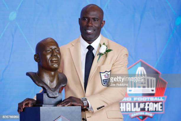 Terrell Davis poses with his bust during the Pro Football Hall of Fame Enshrinement Ceremony at Tom Benson Hall of Fame Stadium on August 5 2017 in...