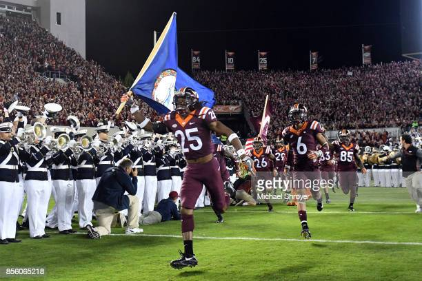 Terrell Edmunds of the Virginia Tech Hokies leads the team on the field prior to their game against the Clemson Tigers at Lane Stadium on September...
