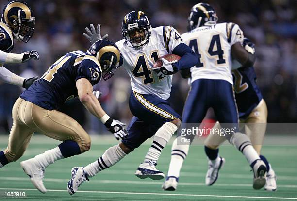 Terrell Fletcher of the San Diego Chargers shoves Adam Archuleta of the St Louis Rams during the NFL game at the Edward Jones Dome on November 10...