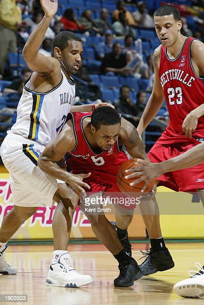 Terrell McIntyre of the Fayetteville Patriots drives past Corey Alexander of the Roanoke Dazzle during Game One of the NBDL Semifinals at the Crown...