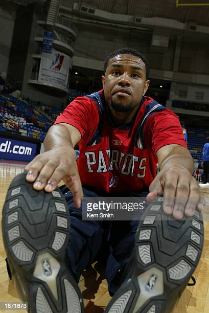 Terrell McIntyre of the Fayetteville Patriots stretches before taking on the Roanoke Dazzle during the NBDL Playoffs at the Crown Coliseum on March...