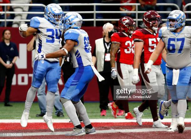 Terrell Newby of Salt Lake Stallions celebrates his touchdown against the San Antonio Commanders with teammate Nick Truesdell during the fourth...