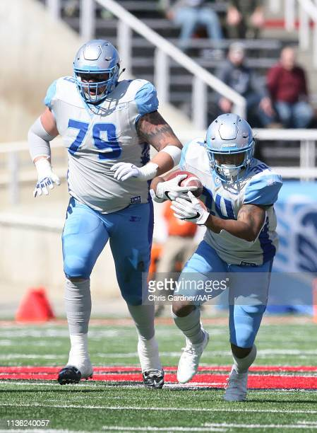 Terrell Newby of the Salt Lake Stallions runs the ball alongside Ryan Cummings as they play against the Memphis Express in the first half at Rice...