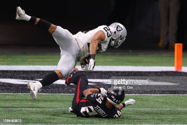 Terrell of the Atlanta Falcons stops Devontae Booker of the Las Vegas Raiders short of the end zone during their NFL game at Mercedes-Benz Stadium on...
