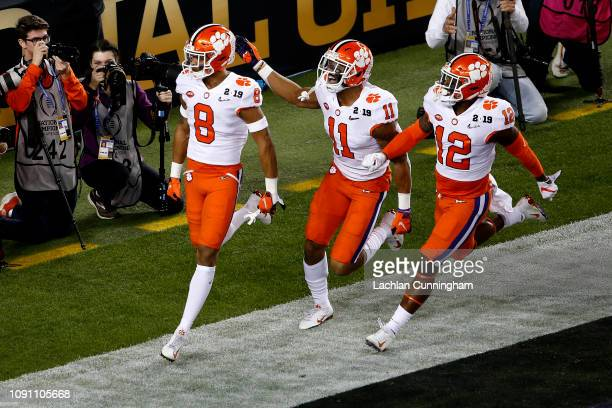 J Terrell of the Clemson Tigers celebrates with his teammates after intercepting a ball thrown by Tua Tagovailoa of the Alabama Crimson Tide during...
