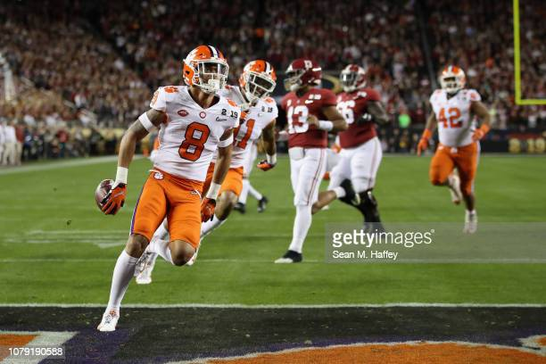 J Terrell of the Clemson Tigers runs back an interception for a first quarter touchdown against the Alabama Crimson Tide in the CFP National...