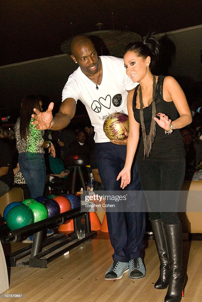 Terrell Owens and Adrienne Bailon attend the 81 Cares Bowl presented by Terrell Owens and GQ Magazine at Star Lanes On The Levee on December 6, 2010 in Newport, Kentucky.