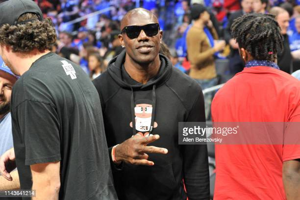 Terrell Owens attends an NBA playoffs basketball game between the Los Angeles Clippers and the Golden State Warriors at Staples Center on April 18...