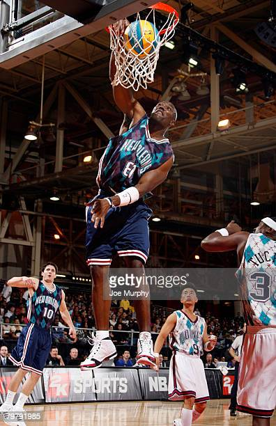 Terrell Owens NFL player dunks during the McDonald's NBA AllStar Celebrity Game on center court during NBA Jam Session Presented by Adidas on...