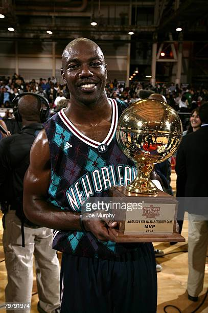 Terrell Owens NFL player wins the MVP Trophy during the McDonald's NBA AllStar Celebrity Game on center court during NBA Jam Session Presented by...
