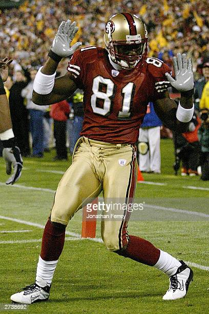Terrell Owens of the 49ers celebrates his touchdown catch during the Pittsburgh Steelers and San Francisco 49ers game on November 17 2003 at...