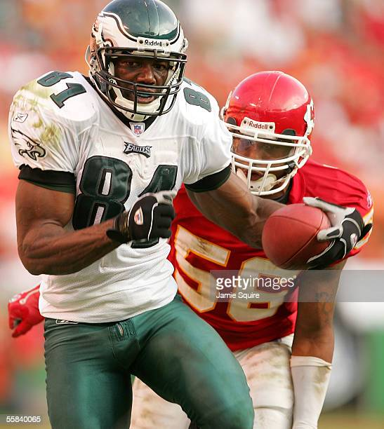 Terrell Owens of the Philadelphia Eagles carries the ball upfield as Derrick Johnson of the Kansas City Chiefs chases during the second half of the...