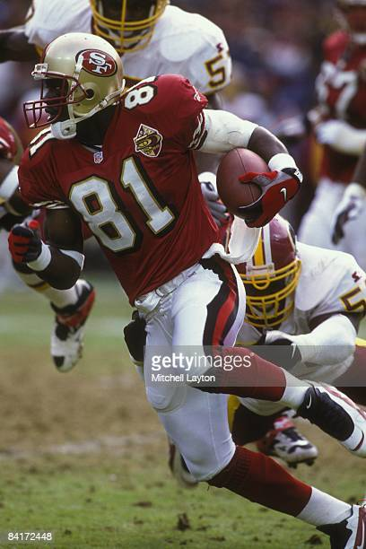 Terrell Owens of the San Francisco 49ers runs with the ball during a NFL football game against the Washington Redskins on September 4 1994 at RFK...