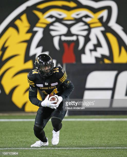 Terrell Sinkwell Jr #14 of the Hamilton TigerCats returns a punt against the Montreal Alouettes in a CFL game at Tim Hortons Field on November 3 2018...