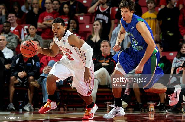 Terrell Stoglin of the Maryland Terrapins brings the ball up the court against the Florida Gulf Coast Eagles at the Comcast Center on November 25...